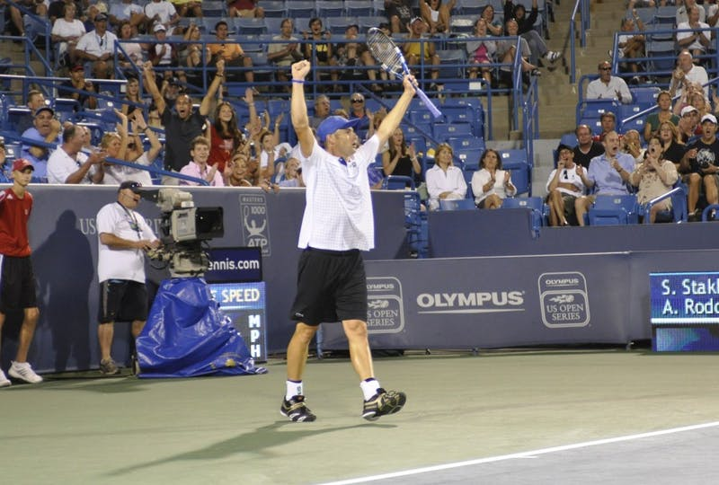 Andy Roddick celebrated after breaking Sergiy Stakhovsky's serve to win the second game of the third set in their first round match Monday.