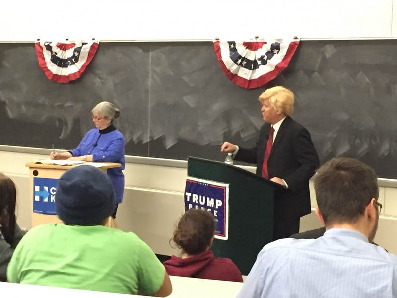 Beth Henschen (left) and Jeffery Bernstein (right) posing as presidential candidates Hillary Clinton and Donald Trump in the Eastern Michigan University Mock Debate on Wednesday, Oct. 26.