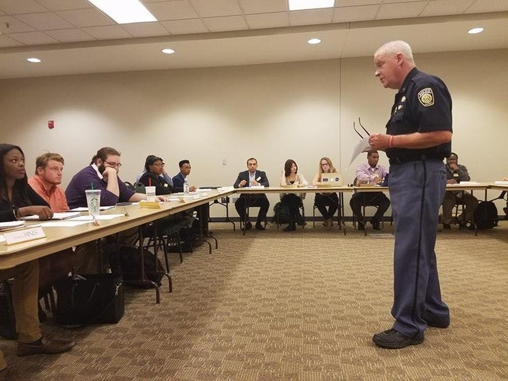 Bob Heighes (right), chief of Eastern Michigan University's police department, speaking with members of Student Government on Nov. 1 regarding EMU PD's investigation of the racial graffiti incidents on campus.
