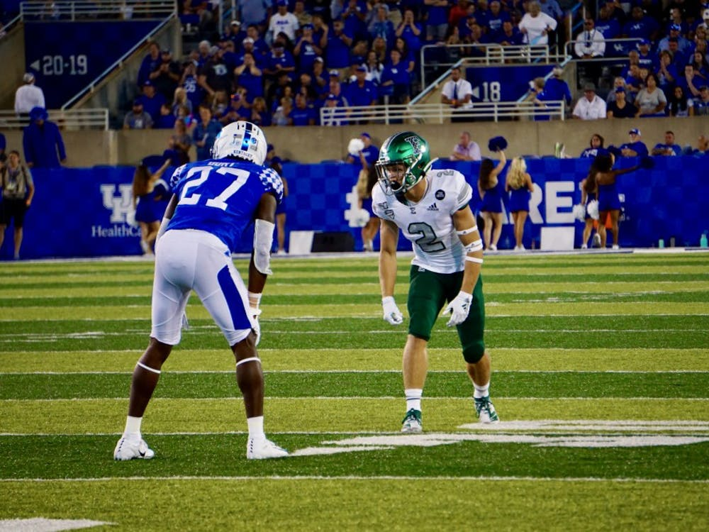 Mathew Sexton lines up versus Kentucky on Sept. 7 at Kroger Field.