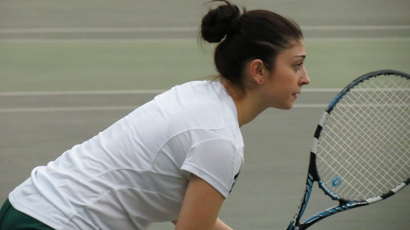 EMU's women's tennis team faces Toledo on April 3, 2013 in Ypsilanti.