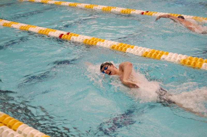 Dylan Crompton powers his way through the water in the 200-freestyle.