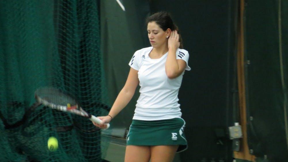 EMU tennis wins matches