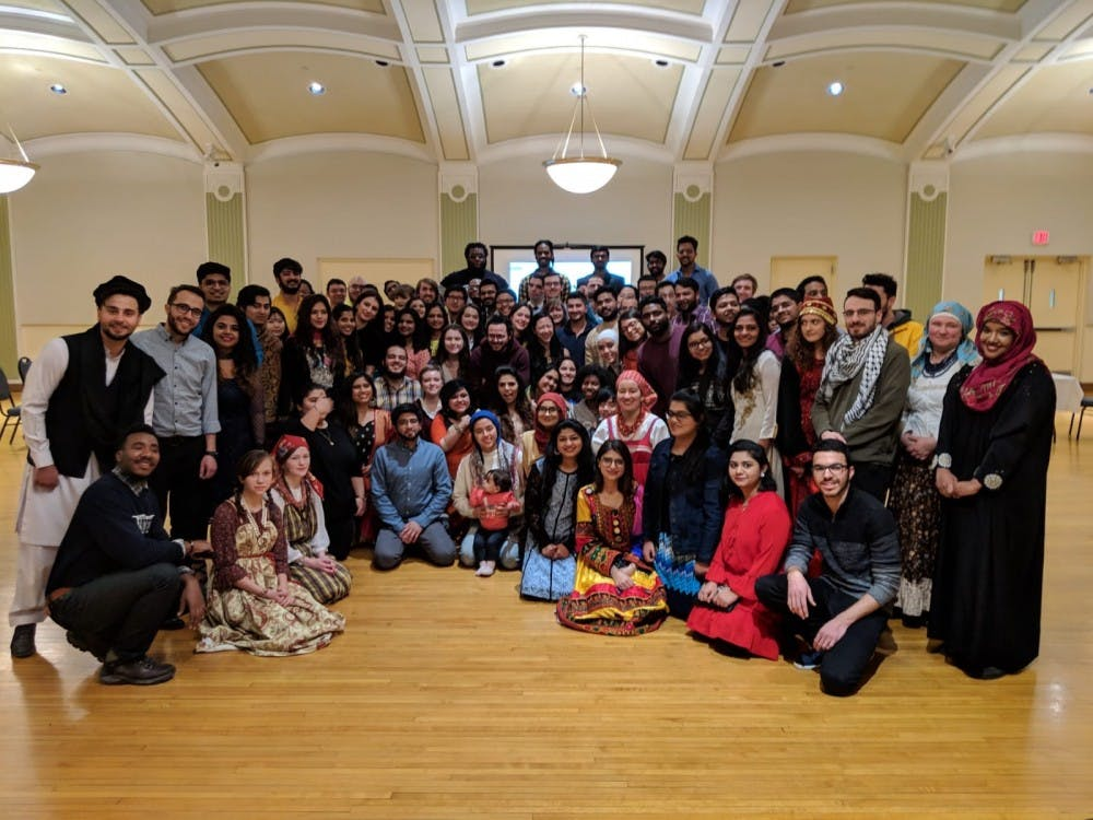 International Student Association board and members gather for cultural night.