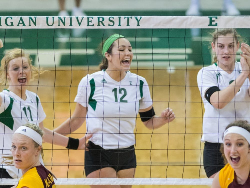 EMU volleyball celebrates a point at the EMU vs. CMU volleyball game on October, 30 2014 at the Convocation Center