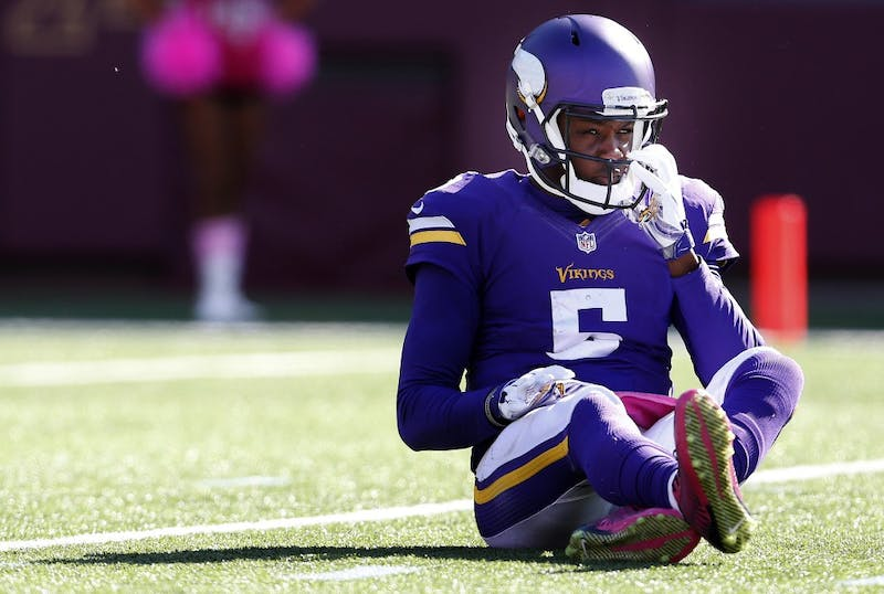 Minnesota Vikings quarterback Teddy Bridgewater (5) sits on the ground after being pressured and hit during the fourth quarter on Sunday, Oct. 12, 2014, at TCF Bank Stadium in Minneapolis. (Carlos Gonzalez/Minneapolis Star Tribune/MCT)
