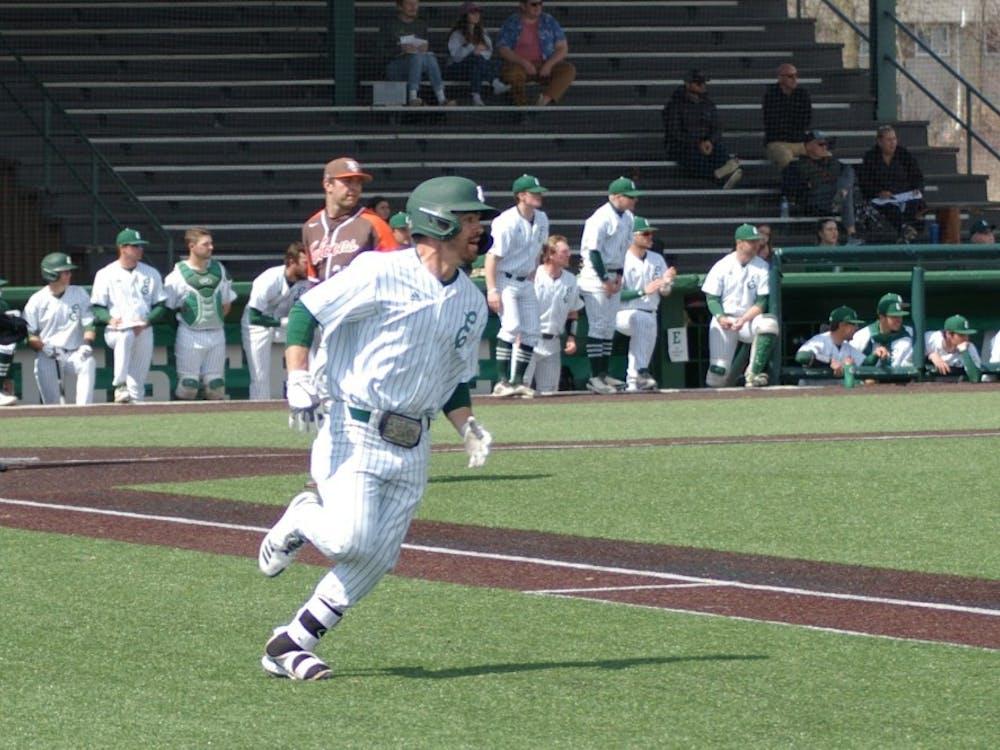 Cameron Cruz runs to first base on April 7 at Oestrike Stadium.