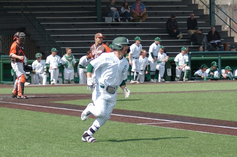Cameron Cruz runs to first base on April 7 at Oestrike Stadium.