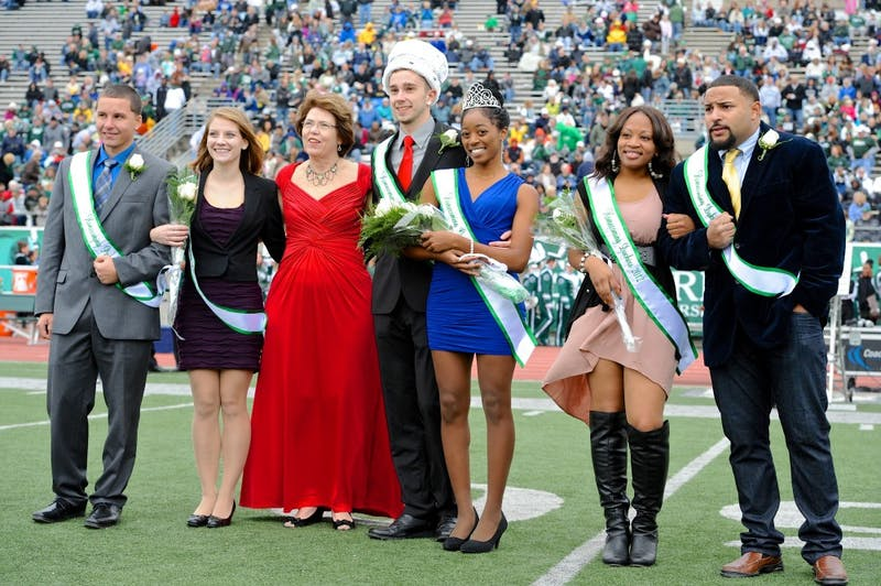 Homecoming king Blake Navarre and queen Ja'La Wourman stand on the Rynearson Stadium field during halftime of the Eagles football game against Kent State.