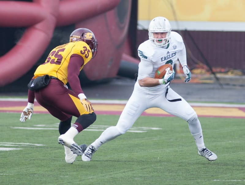 Eastern Michigan wide receiver makes catch against Central Michigan in Mount Pleasant.