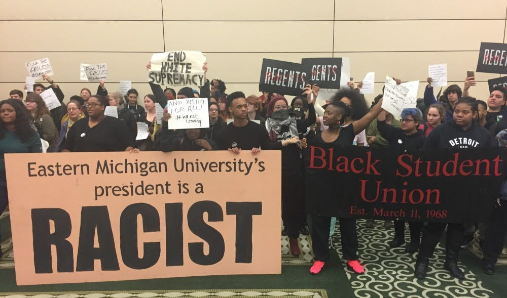 Following more sanctions protesters label EMU's president a racist