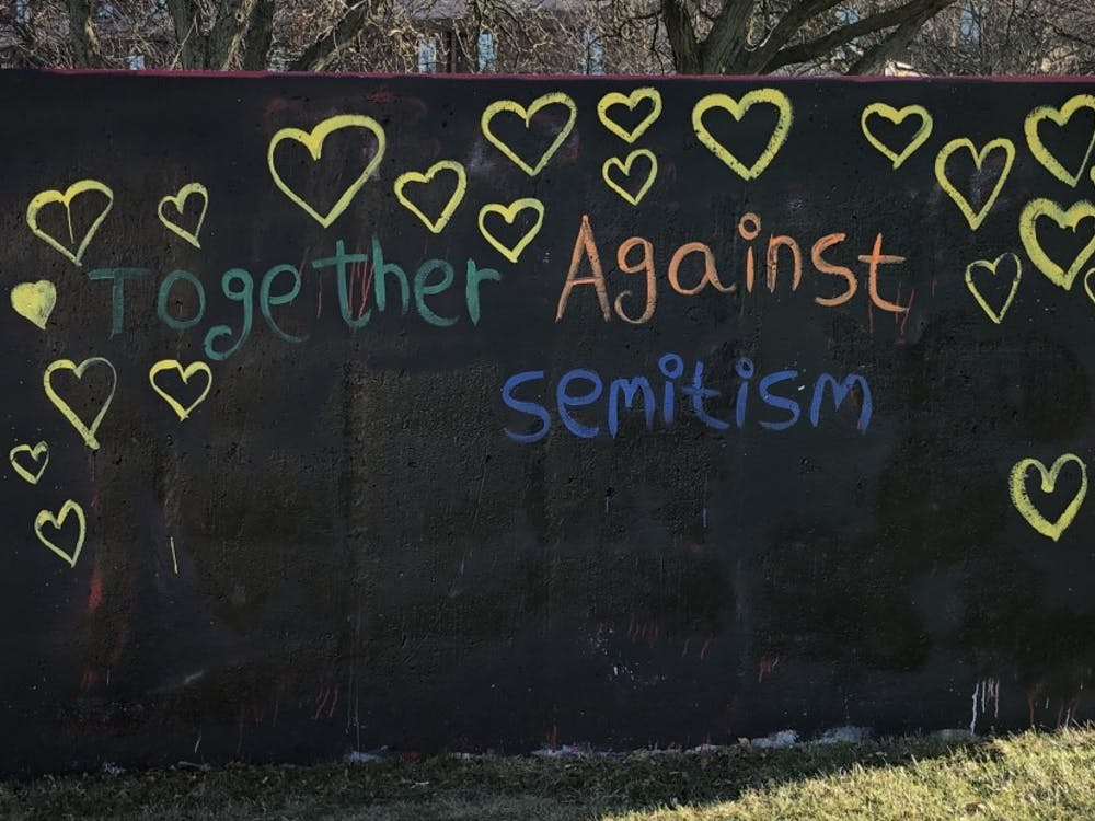 "The ""Together Against Antisemitism"" message painted by Hillel at EMU after it was tampered with, now reading ""Together Against Semitism."""