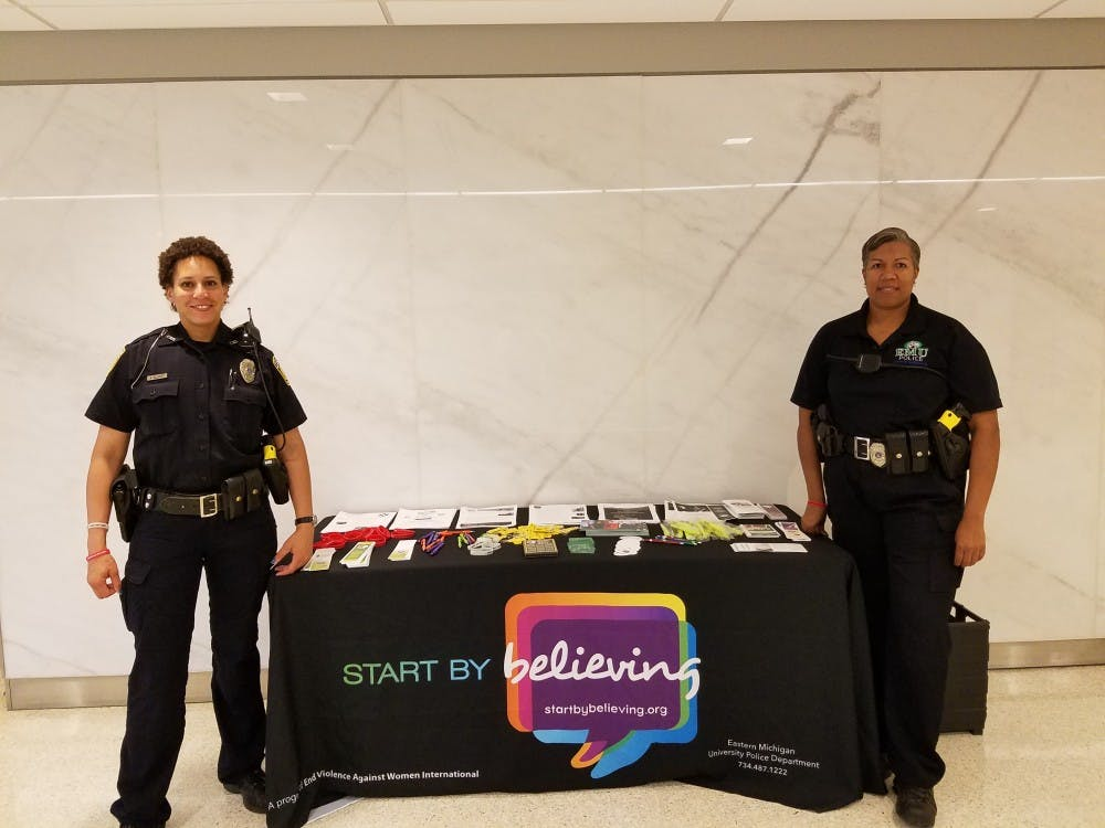 "Detective Elliott (left) and Officer Dorsey (right) of Eastern Michigan University's Special Victims Unit promoting the ""Start by Believing"" awareness event on Oct. 10."