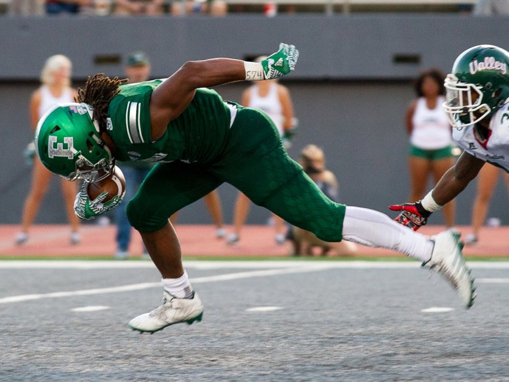 EMU running back Shaq Vann bursts past the defense during the Eagles' 61-14 win.