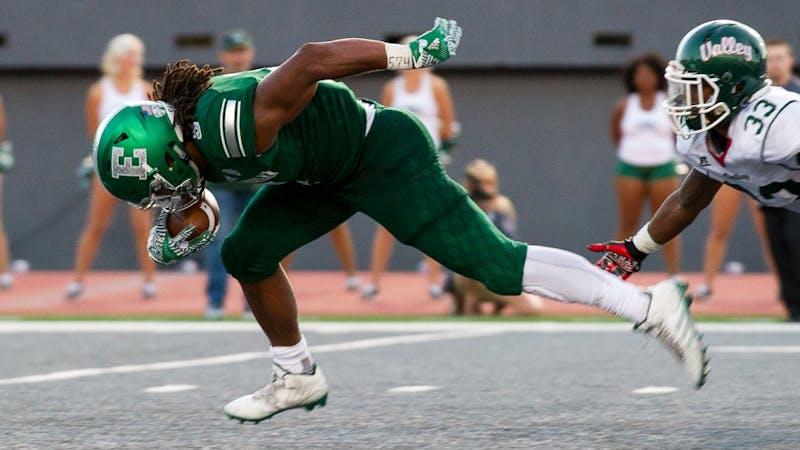 EMU running back Shaq Vann bursts past the defense during the Eagles' 61-14 win.