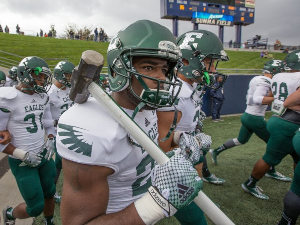 An Eastern Michigan player carries the sledgehammer onto the field before the Eagles took on Akron Saturday afternoon in Akron, Ohio.