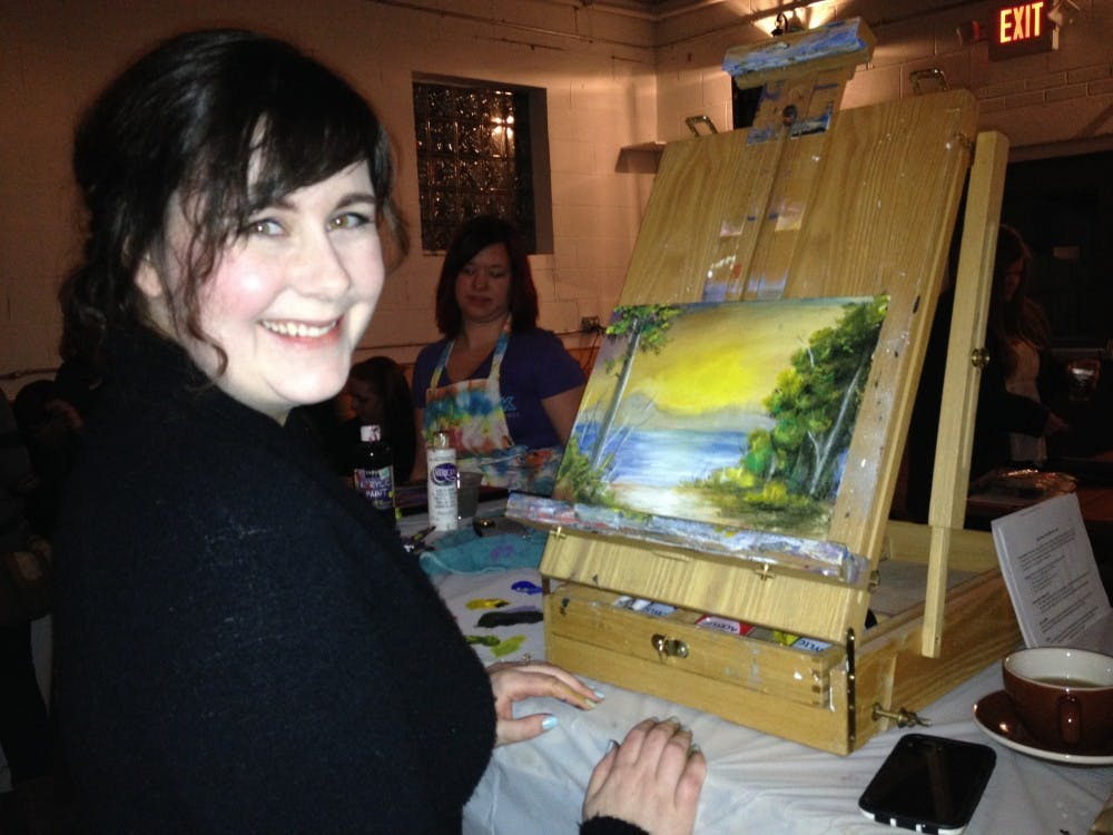 Artist, Nellie Hutchinson, painted a landscape scene in the 30-minute time frame.