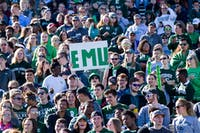 A fan holds up a sign during Eastern Michigan-Toledo football game on Oct. 8 at Rynearson Stadium.