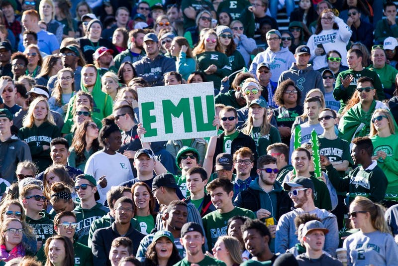 A fan holds up a sign reading 'EMU' during the Eastern Michigan-Toledo football game on Oct. 8 in Rynearson Stadium.