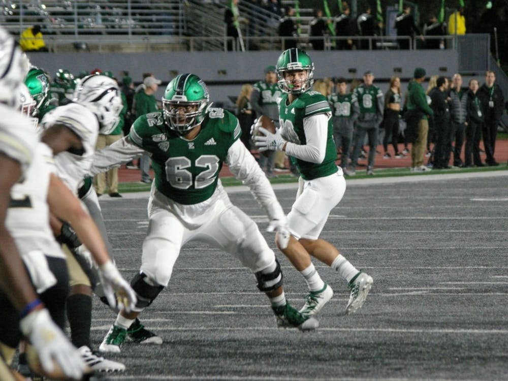 EMU quarterback Preston Hutchinson drops back for pass at Rynearson Stadium on Oct. 19.