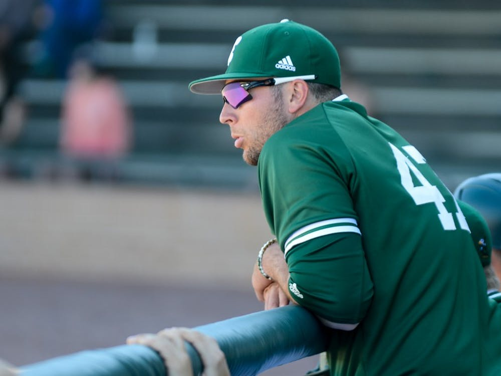 Kevin Shul watches from the dugout versus Kent State in Ypsilanti on April 16.