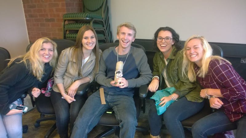 The winning group won a candle in the shape of the Water Tower. From right to left:Erin Beyer, Alyssa Licavoli, Rob Cottrell, Adrianna Sputa and Kate Mueller.