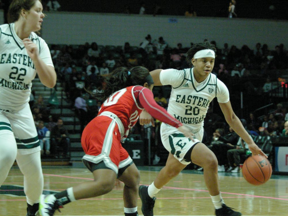 EMU guard Corrione Cardwell dribbles to her left at the Convocation Center on Nov. 8.