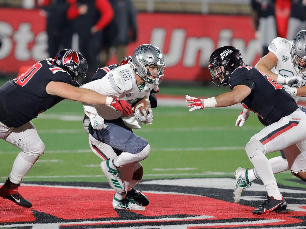 Preston Hutchinson runs on a quarterback-keeper in the Eagles' game against Ball State on Wednesday, Nov. 11.credit: Walt Middleton/EMU Athletics