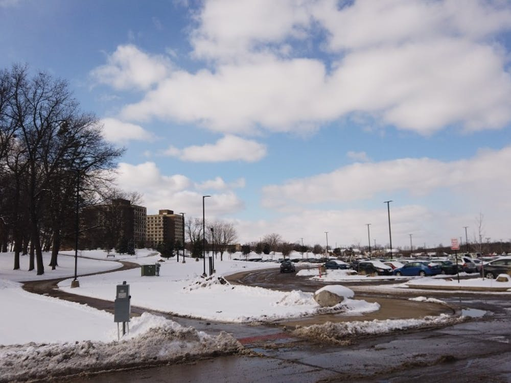 A picture of the green lot and the towers in the distance.