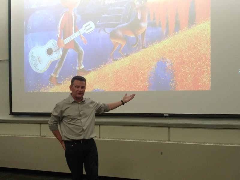 Chris Bernardi motions to a still image from Pixar's 'COCO'