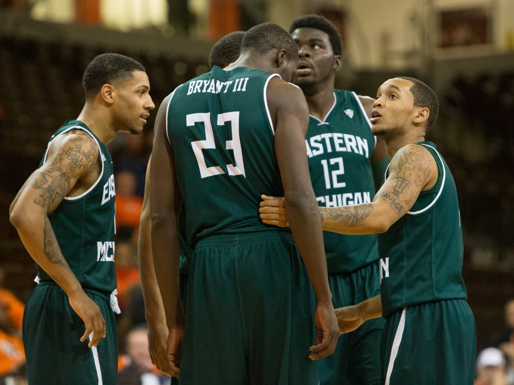 The team talks quick before a free throw attempt in Eastern Michigan's 56-51 win over Bowling Green Wednesday night.