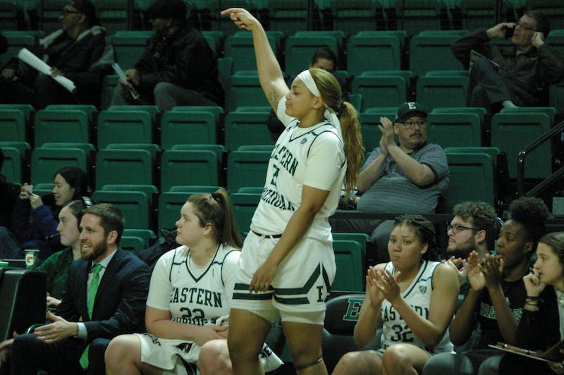Kiara Johnson celebrates on the bench at the Convocation Center on Jan. 22.