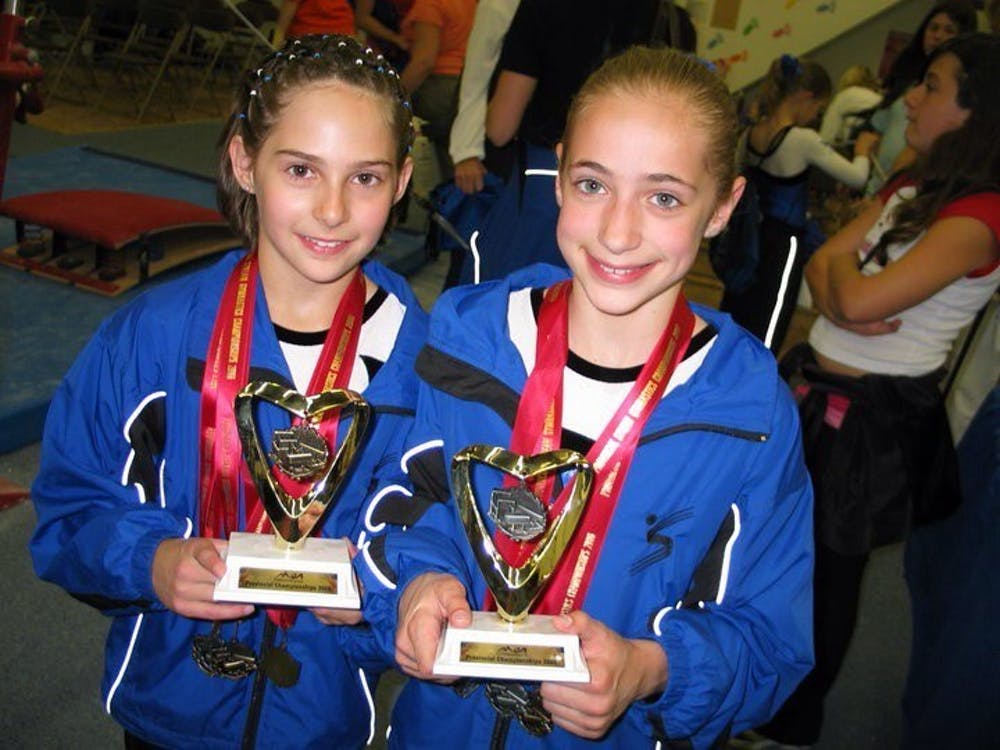 Sydney, left, and Natalie after a meet in 2006.