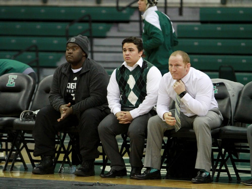 EMU student Ramone Williams, who was previously homeless, is named honorary captain during the match against Kent State at the Convocation Center in Ypsilanti on Sunday January 17, 2016.