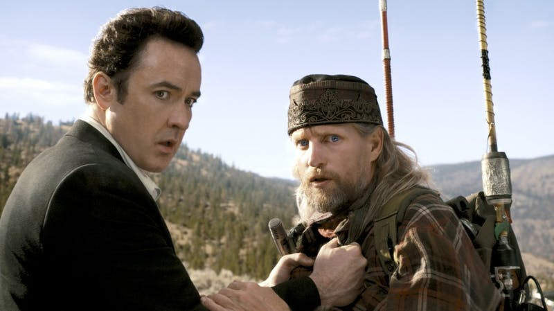 """John Cusack, left, and Woody Harrelson star in Columbia Pictures """"2012.""""  The action film, released Nov. 13, depicts the end of the world as predicted by the Mayan calendar"""