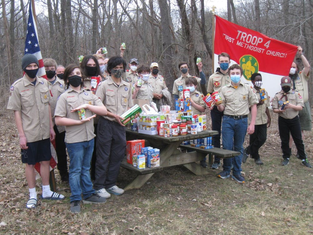 Boy Scout Troop 4 collecting canned and dry goods as donations for their annual food drive with Food Gatherers. (Photo courtesy of Food Gatherers)