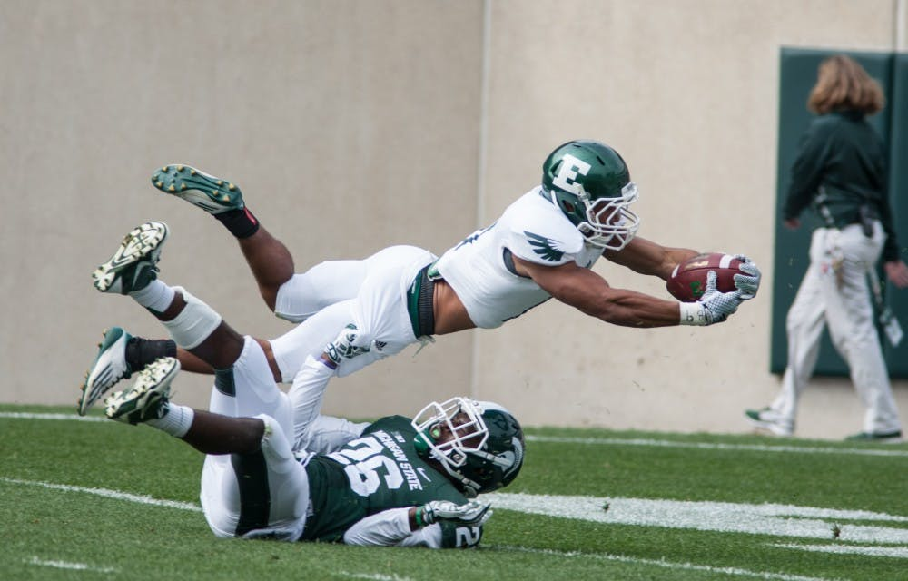 Eagles blown out by Spartans, 73-14