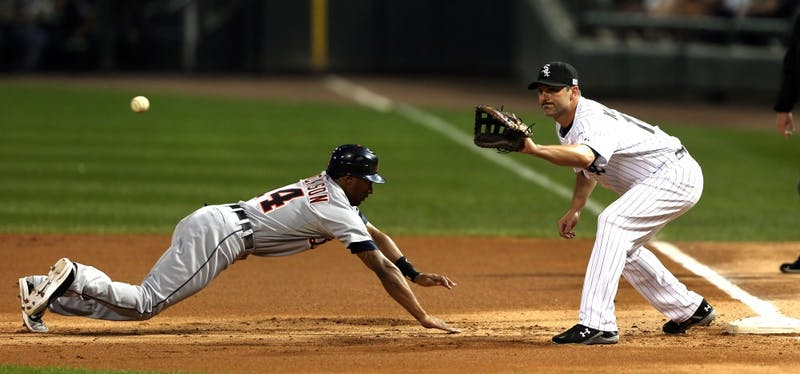 The Detroit Tigers' Austin Jackson (14) dives back to the bag as Chicago White Sox first baseman Paul Konerko takes the throw on a pick-off play in the first inning at U.S. Cellular Field in Chicago, Illinois, on Tuesday, September 11, 2012. (Chris Sweda/Chicago Tribune/MCT)