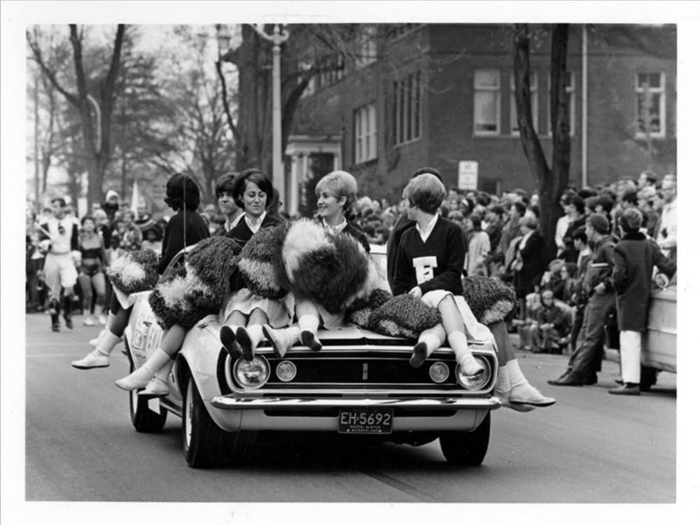 Eastern Michigan University cheerleaders participate in 1967 homecoming parade. (Photo credit of Eastern Michigan University.)