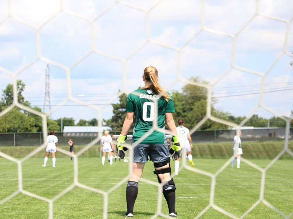 Senior goalkeeper Megan McCabe looks over the field as her team gets ready to kick-off.