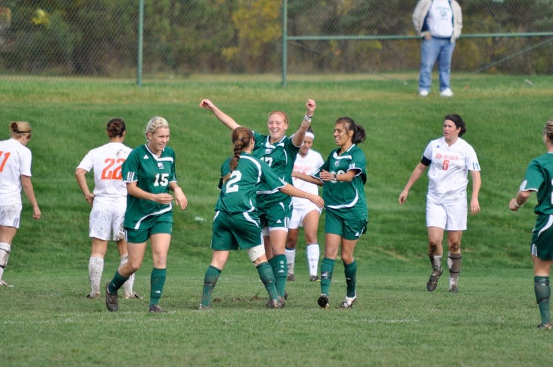 Amanda Marsh (2) celebrates her goal with teammates Sunday.