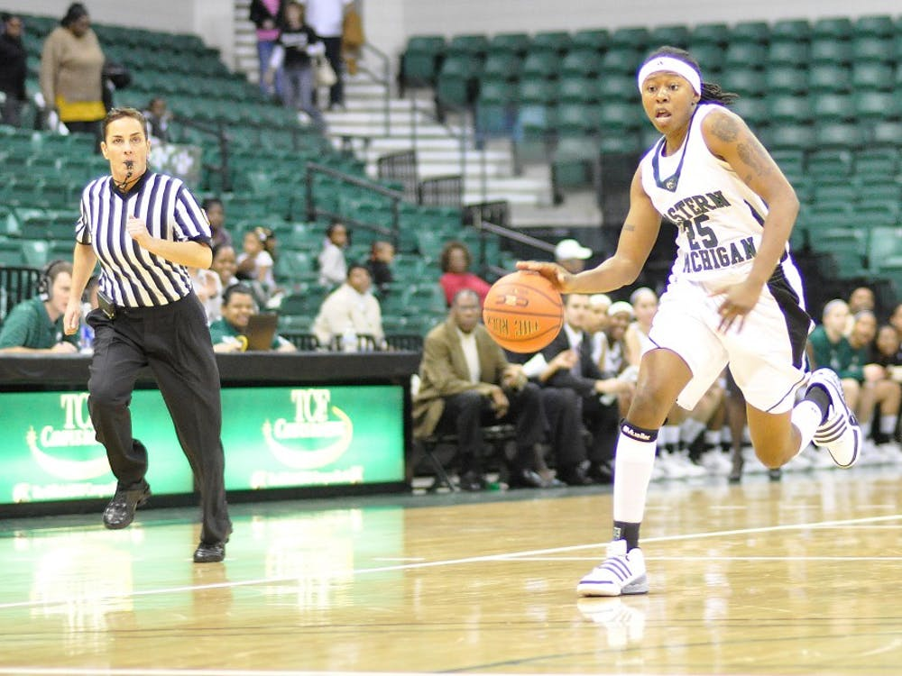 Junior college transfer Kristin Thomas, shown in a Nov. 7 exhibition, is averaging 11 rebounds.