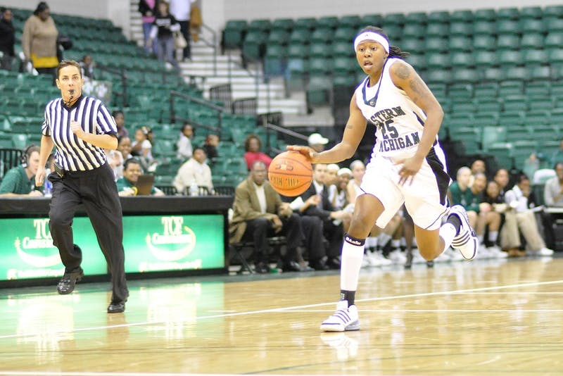 Junior college transfer Kristin Thomas, shown in a Nov. 7 exhibition, is averaging 11 rebounds.