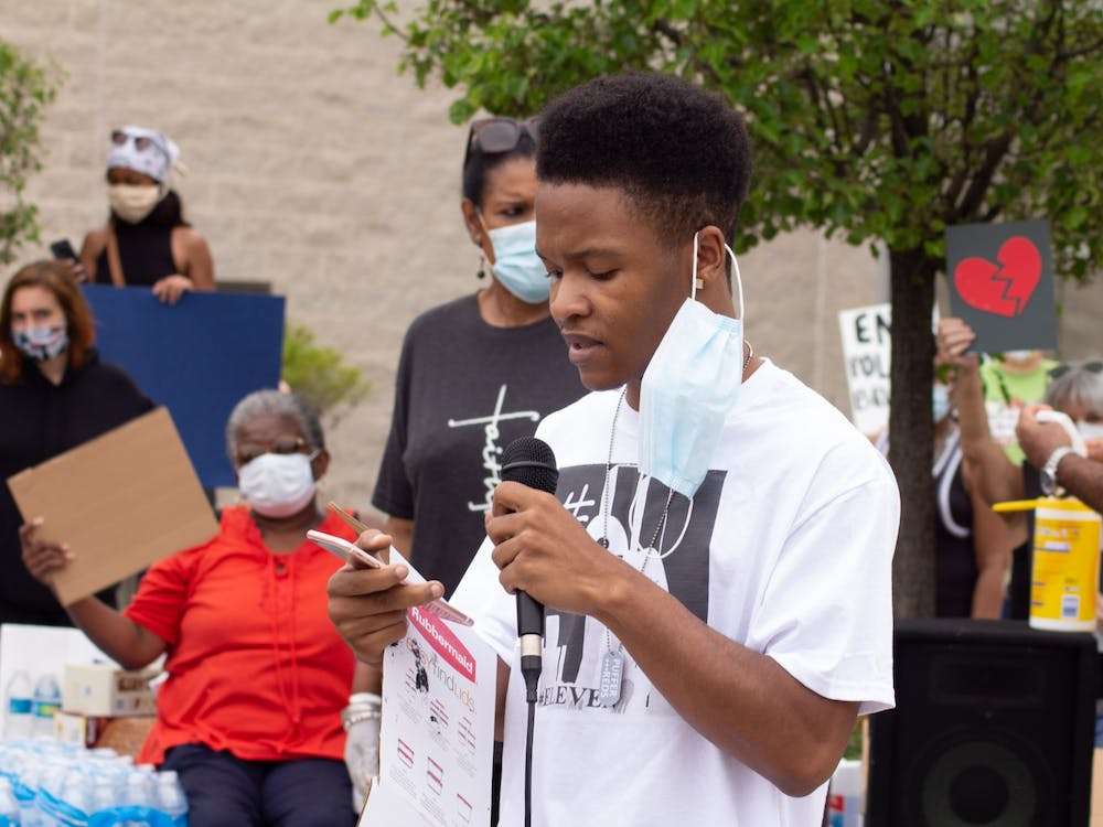 Ypsilanti-based rapper, Kid Jay, performs a rap at a protest on May 27 in response to the violence displayed by a Washtenaw County Deputy.