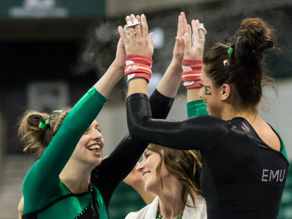 Kendall Valentin celebrates after her routine versus Kent State on February 7, 2015 at the Convocation Center.
