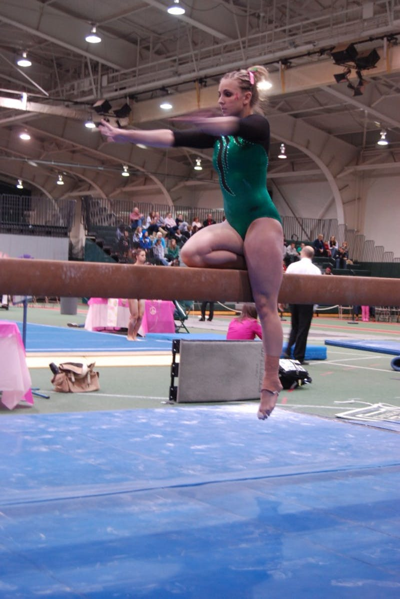 Kaylyn Millick, shown above at an earlier meet,  led the team at the championship with a score of 9.775 on the balance beam.