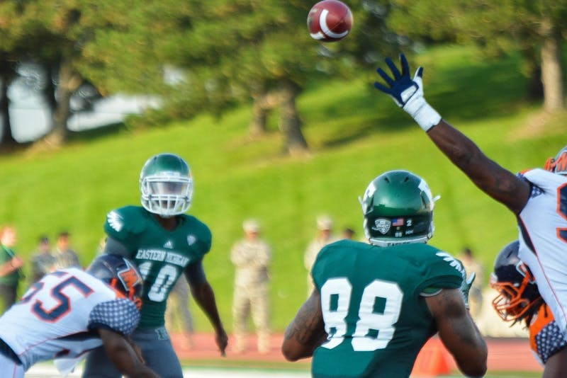 Reginald Bell Jr. completes a pass to versus Morgan State on Aug. 31 at Rynearson Stadium.