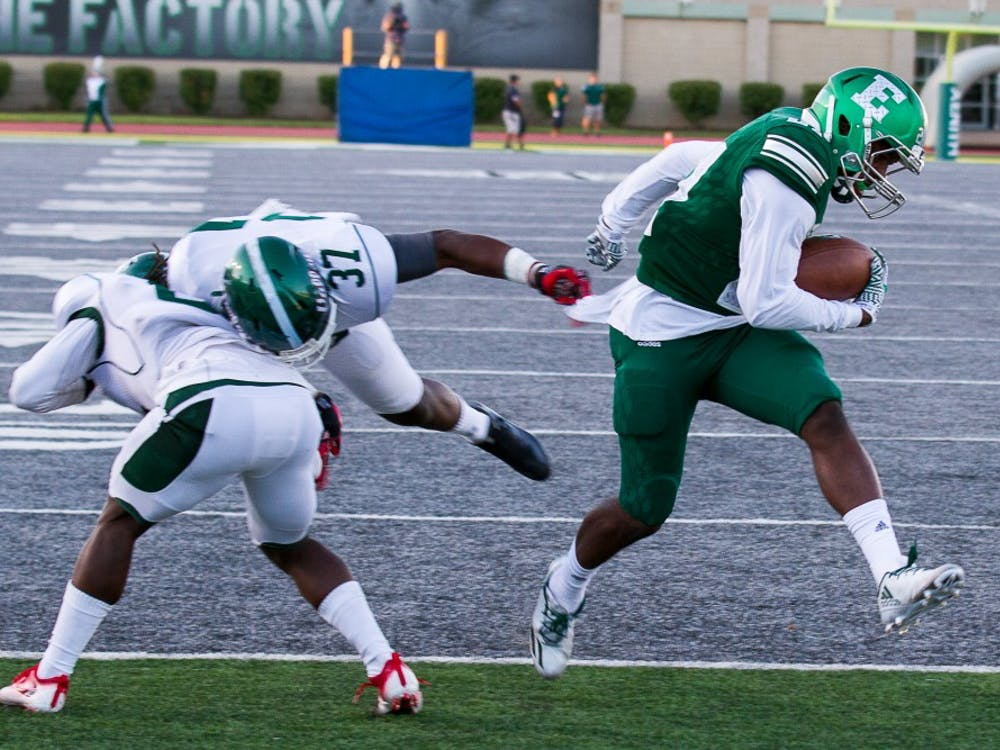 EMU receiver slips past two defenders for a touchdown on September 2.
