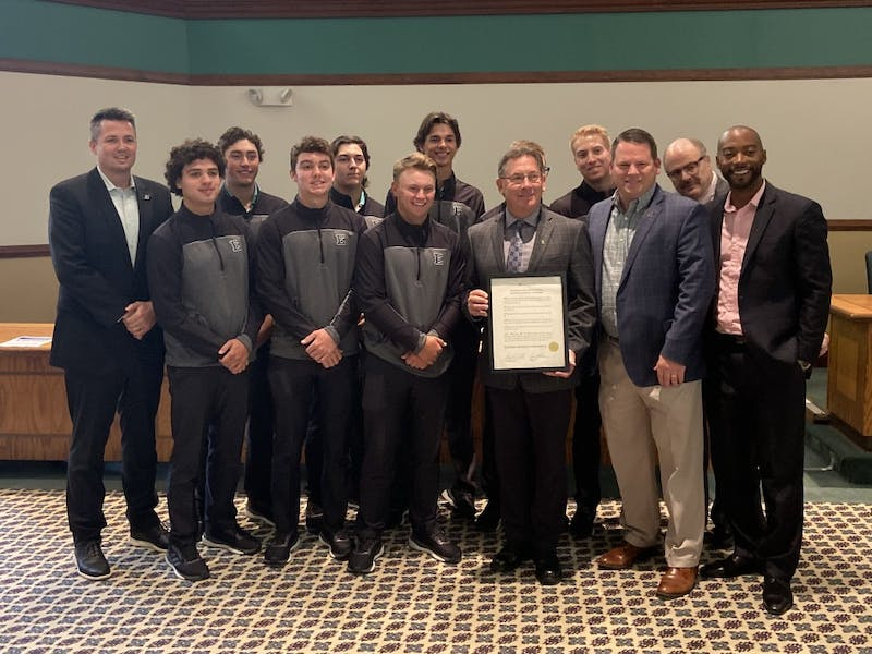 The EMU Board of Regents present the men's golf team with a special recognition for their 2019 championship at Welch Hall.