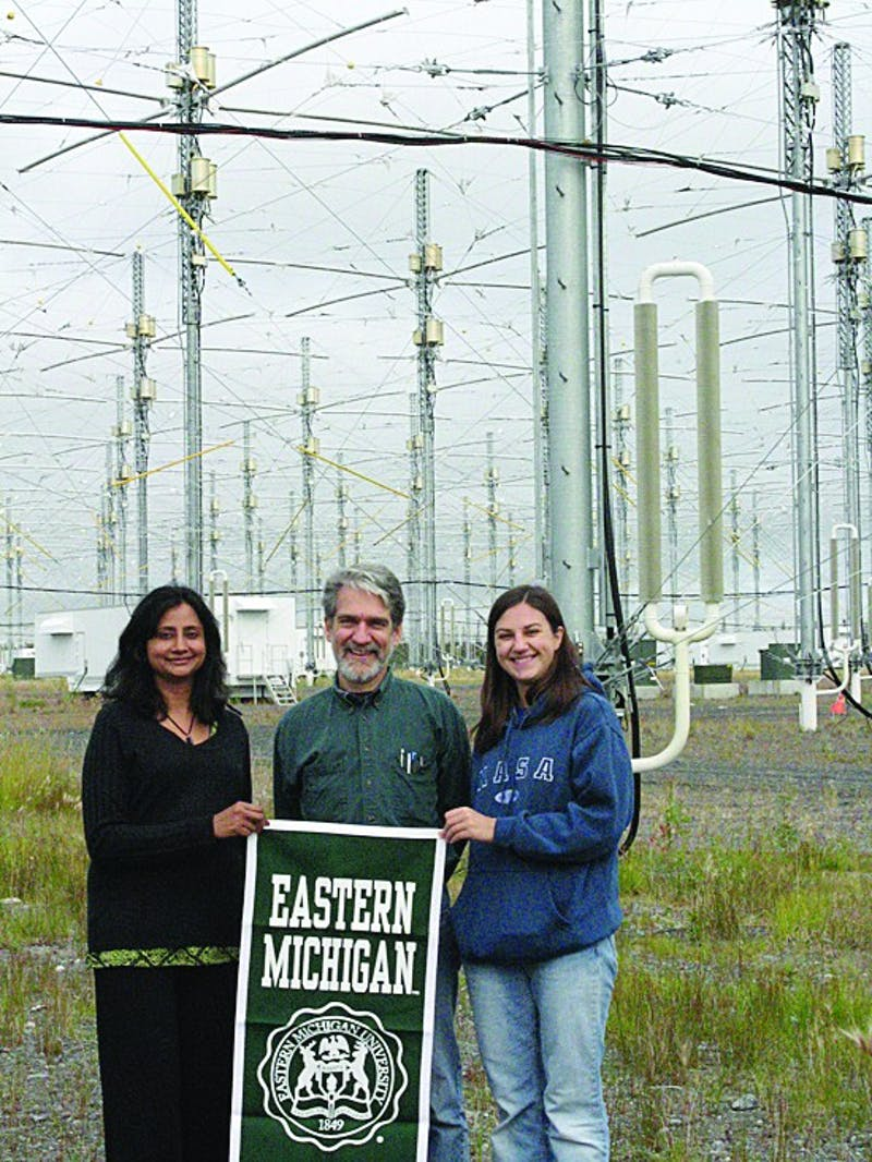Left to right: Nargis Adham, Prof Sheerin, and Audelia Wittbrodt under the 35-acre HF antenna array.